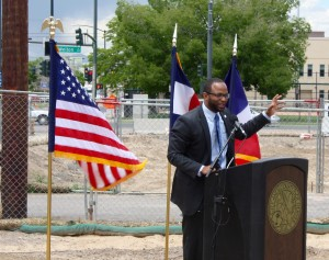 Denver City Councilman Albus Brooks addresses the crowd at the 2300 Welton ground breaking ceremony.