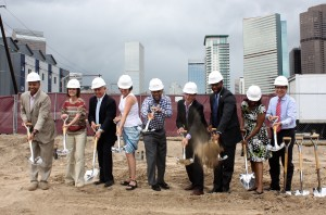 Members of the development team along with Denver Mayor Michael Hankcock and City Councilman Albus Brooks break ground on 2300 Welton.