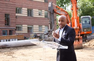 Denver Mayor Michael Hancock addresses the crowd at the Country Club Towers ground breaking.